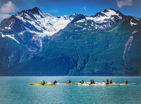 A group of scouts kayak past stunning views of the Rainbow Glacier