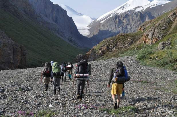 Scouts backpack through alpine passes with nearby glaciers in sight