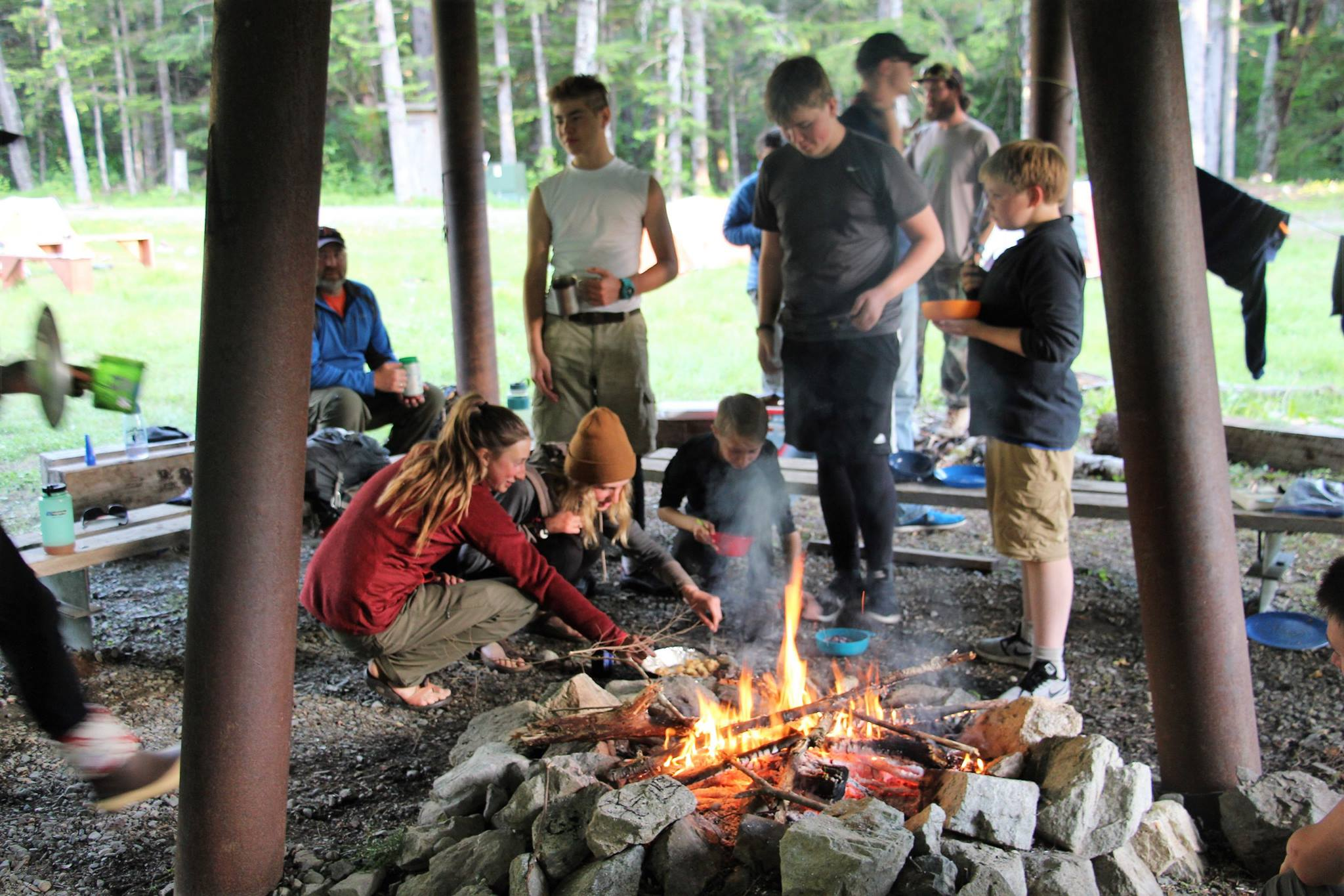 Scouts enjoy roasting smores on the adventure base's covered firepit